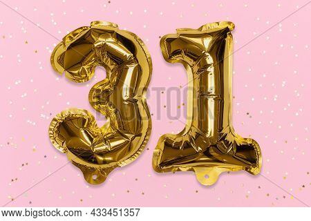 The Number Of The Balloon Made Of Golden Foil, The Number Thirty-one On A Pink Background With Sequi