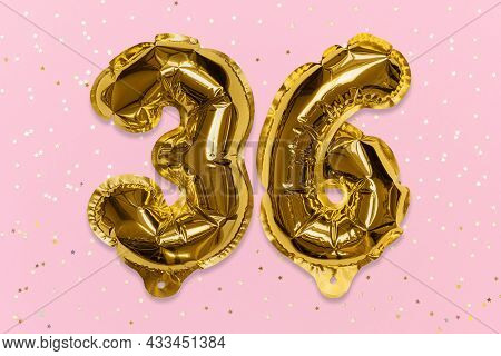 The Number Of The Balloon Made Of Golden Foil, The Number Thirty-six On A Pink Background With Sequi