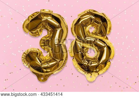 The Number Of The Balloon Made Of Golden Foil, The Number Thirty-eight On A Pink Background With Seq