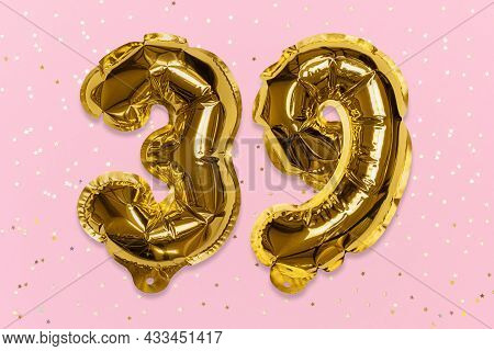 The Number Of The Balloon Made Of Golden Foil, The Number Thirty-nine On A Pink Background With Sequ