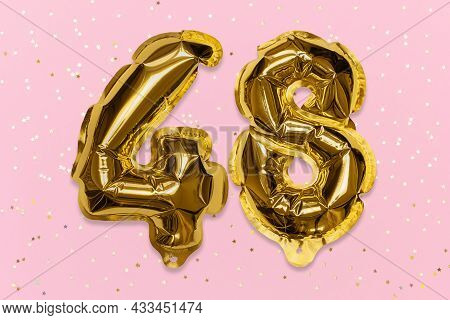 The Number Of The Balloon Made Of Golden Foil, The Number Forty-eight On A Pink Background With Sequ