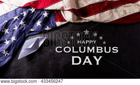 Happy Columbus Day Concept. Vintage American Flag With Paper Boat With The Text On Dark Stone Backgr