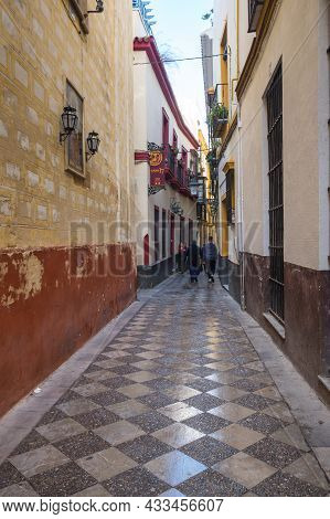 Seville, Spain - 08 April, 2019: View Of The Street In The Historical Center Of Seville, A Big Touri