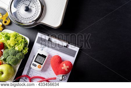Stethoscope With Patient's Blood Sugar Control Chart, Diabetic Measurement  Set And Sugar On Blackbo