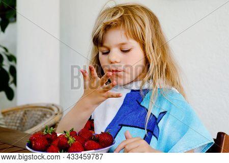 Little Preschool Toddler Girl Eating Fresh Strawberries. Adorable Baby Child Tasting And Biting Ripe