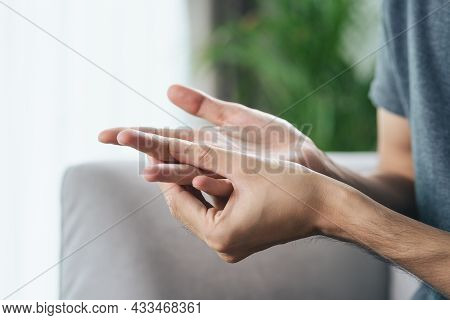 Man Suffering From Hand And Finger Joint Pain. Causes Of Rheumatoid Arthritis, Carpal Tunnel Syndr