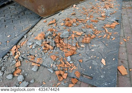 Damage To A Tiled Roof, Destroyed Roof Tiles, Ceramic Roof Tiles On Ground
