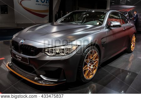 Bmw M4 Coupe Sports Car Showcased At The Brussels Expo Autosalon Motor Show. Belgium - January 12, 2