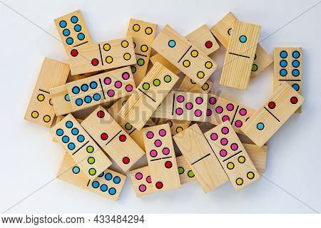 Top View Of Heap Wooden Dominoes Gaming Pieces On The White Background