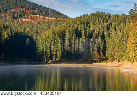 Landscape At The Mountain Lake In Autumn. Beautiful Nature Scenery In The Morning. Spruce Forest On