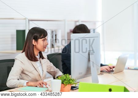 Portrait Of Charming Working Female Looking At Computer During Work Job At Office
