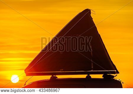 Car With Roof Top Tent Camping On Mediterranean Coast At Sunrise. Holidays And Traveling.