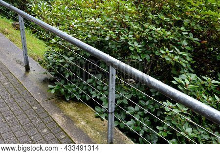 Metal Railing On The Edge Of The Park Path Above The Slope. Rope Stainless Steel Cable Railings.\nan
