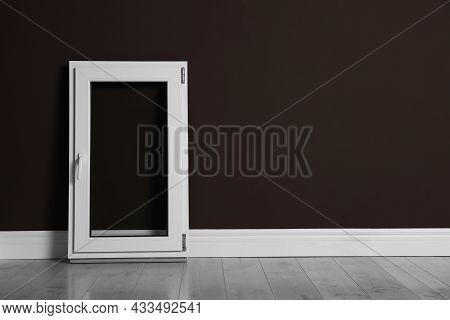 Modern Single Casement Window Near Dark Brown Wall Indoors, Space For Text