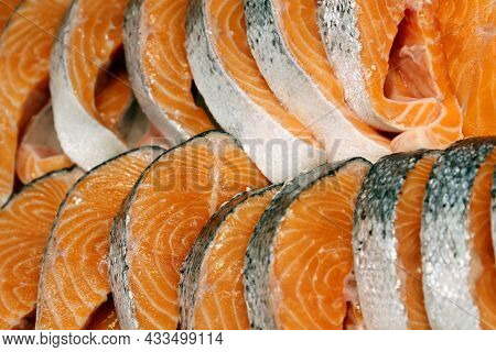 Fresh Pink Salmon Steaks In The Ice. Red Fish In The Market, Concept Of Healthy Food With Omega Fats