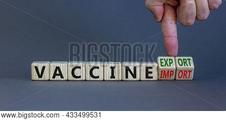 Covid-19 Vaccine Export Or Import Symbol. Doctor Turns Cubes, Changes Words Vaccine Import To Vaccin