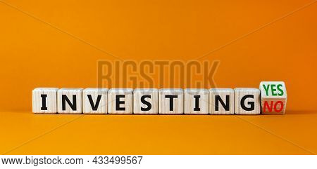 Investing Yes Or No Symbol. Turned A Wooden Cube And Changed Words 'investing No' To 'investing Yes'