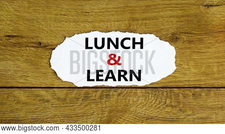Lunch And Learn Symbol. Words 'lunch And Learn' On White Paper. Beautiful Wooden Background. Busines