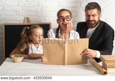 Father Have Fun With Cute Schoolchild Girls. Father And Little Kids Daughters. Love Family, Teachers