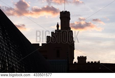 Silhouette Of The Tower Of Lednice Castle With Clouds At Sunset. The Castle Was Inscribed On The Une