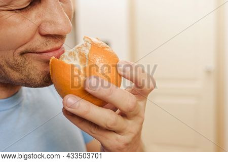 Young Healthy Man Feeling Citrus Aromat After Loss Of His Sense Of Smell Because Of Illness