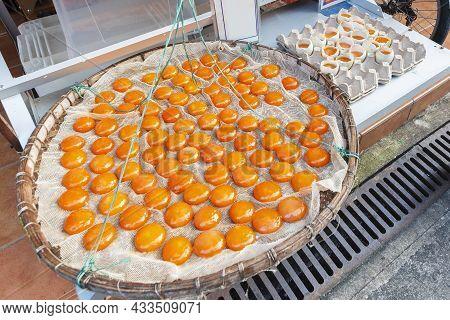 Orange Duck Egg Yolks In Winnow Basket, Tai O Village, Hong Kong