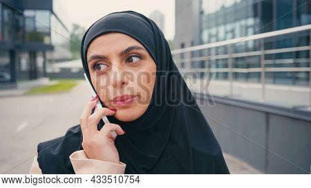 Arabian Woman In Hijab Having Phone Call Outside
