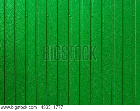 Background Of Green Corrugated Metal Sheet. Modern Technologies In Construction. Metal Tiles. Reliab