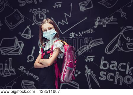 Angry Schoolgirl In Protective Mask Is Preparing To Go To School. Virus Protection For Children