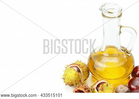 Fruit And Oils Chestnuts Isolated On A White Background. Free Space For Text.