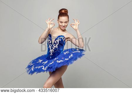 Its Ok, Portrait Of Beautiful Ballerina Woman In Blue Costume With Makeup And Bun Collected Hair Sta
