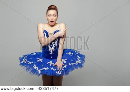 Surprised Portrait Of Beautiful Ballerina Woman In Blue Costume With Makeup And Bun Collected Hair S