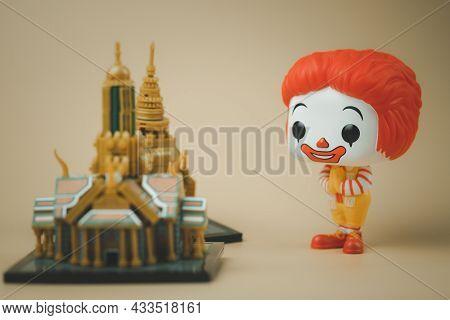 Bangkok, Thailand - September 21, 2021 : Cute Figurine Of Ronald Mcdonald's With Wai Pose. Thailand