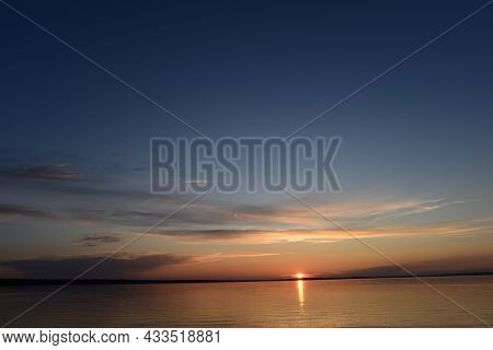 Sunbeam Of The Setting Sun On The Horizon On The Water Surface