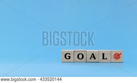 Business Goal. Word Goal Written On Wooden Cube Block Stack On Blue Background, New Year Congratulat
