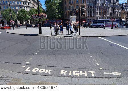 London, Uk - July 6, 2016: People Cross A Street At Trafalgar Square In London. The