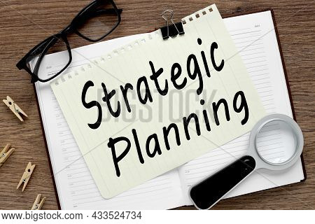 Strategic Planning. Notepad Page On Notepad On Wood Table. With Place For Text. Near Office Supplies