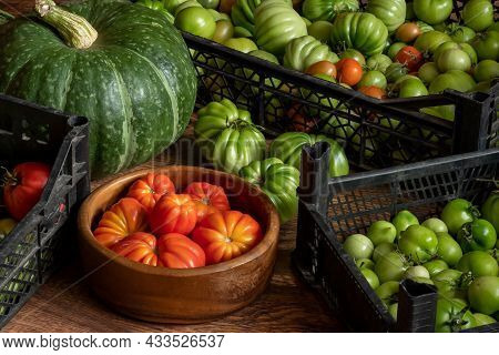 Harvest Of Ripe And Unripe Tomatoes In Crates, Pumpkin And Basket With Hazelnuts Stacked On The Floo