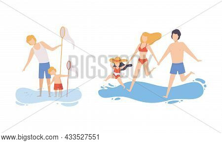 Family At Beach Scene With Father, Mother And Kid Having Fun Catching Fish With Net And Splashing In