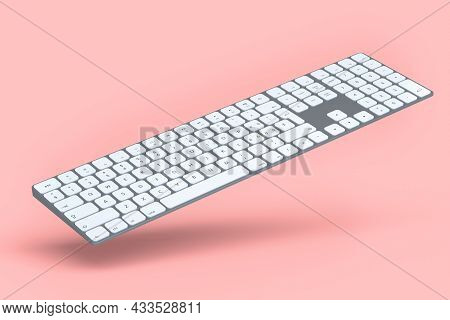 Modern Aluminum Computer Keyboard Isolated On Pink Background.