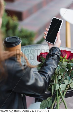 Partial View Of Young Woman Holding Smartphone With Blank Screen And Paper Cup On Terrace Of Cafe