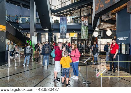 Belfast, Uk, Aug 2019 Crowds Of Tourists Visiting Titanic Museum. People In Entrance Hall In Titanic