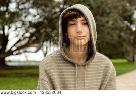 portrait of teenager boy on natural background. adolescence and youth concept. casual look