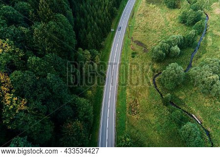 Cars Moving On Countryside Road Through Mountains Covered With Pine Tree Forest, Aerial View. Car Tr