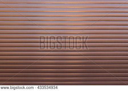 Brown Roller Shutter Door Or Curtain. Grunge Brown Metal Foldable Door Background And Texture.