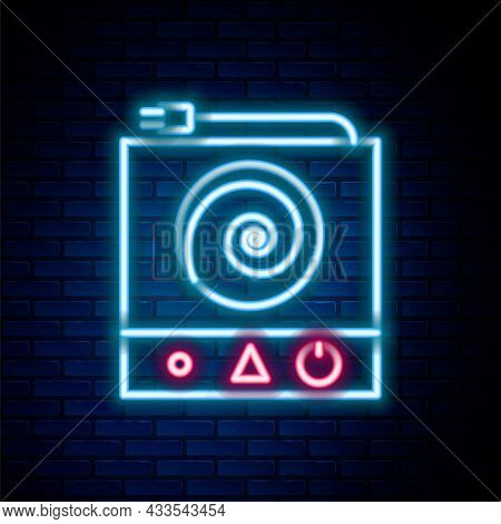 Glowing Neon Line Electric Stove Icon Isolated On Brick Wall Background. Cooktop Sign. Hob With Four