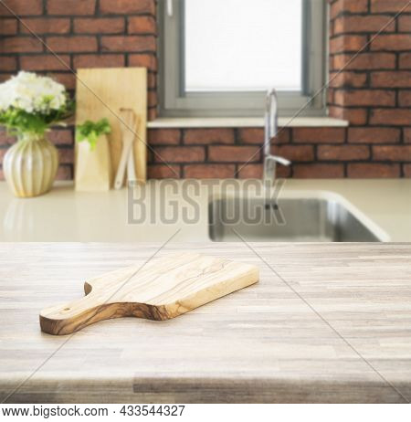 Wood Counter Top On Blur Kitchen Room Background. For Montage Product Display Or Key Visual Layout.