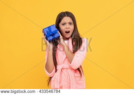 Curious Upset Teen Girl In Home Terry Bathrobe With Gift Or Present Box, Curiousity