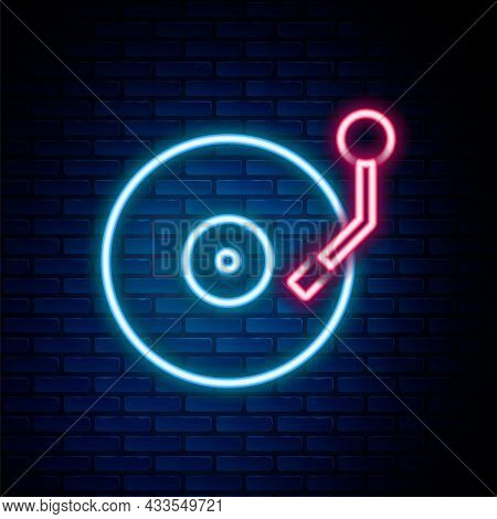 Glowing Neon Line Vinyl Player With A Vinyl Disk Icon Isolated On Brick Wall Background. Colorful Ou