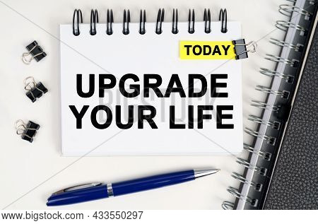 Business Concept. On The Table Is A Pen And A Notebook With Inscriptions - Today And Upgrade Your Li
